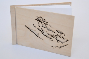 Emily Moore, Hand-bound artists book: hand-cut paper pages, laser-cut Birch plywood cover, 2012